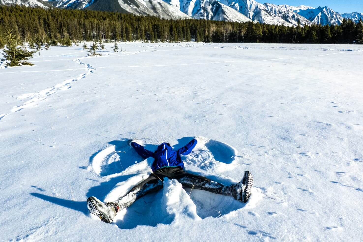 100 best things to do in Banff National Park, Canada - Make a snow angel on the frozen lake