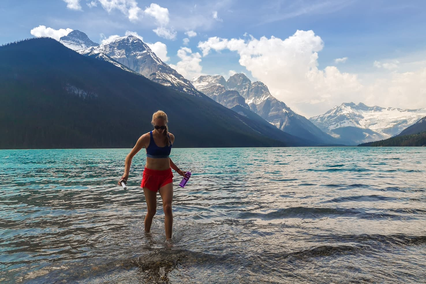 Banff Packing List - drinking with Lifestraw bottle from Glacier Lake, Banff National Park